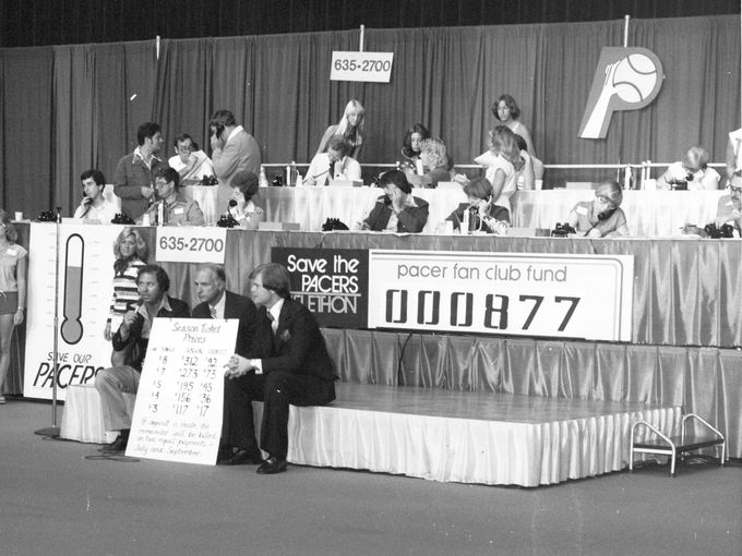 "Gary Todd, 1070-WIBC radio morning man, Indianapolis Mayor Bill Hudnut and Chet Coppock, TV sportscaster show the ticket chart during the ""Save the Pacers"" Telethon in July 1977. (IndyStar File Photo)"