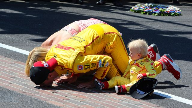 Ryan Hunter-Reay and his family kiss the bricks after his 2014 win.