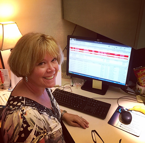 Julie working hard to get clients on the air.