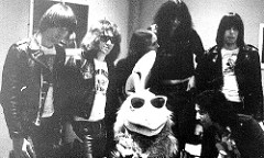 The Ramones and The San Diego Chicken backstage after a radio station KGB sponsored concert.   Other rock 'n roll legends the famous mascot performed with on stage include Paul McCartney, Elvis Presley, Doobie Brothers, Sammy Hagar and more.