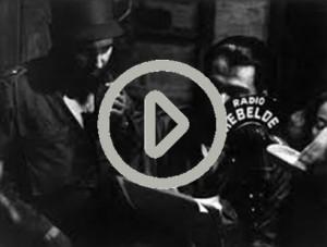 castro and Che_Radio Rebelde with play button