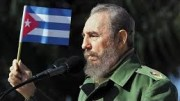 castro-with-cuban-flag-at-mic