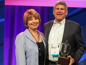 Radio Ink Publisher Deborah Parenti with Emmis Chairman/CEO Jeff Smulyan, the 2016 Radio Wayne winner for America's Best Broadcaster