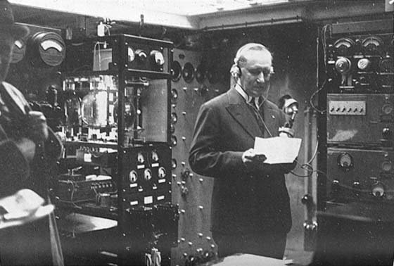 Marconi with headset and big equipment