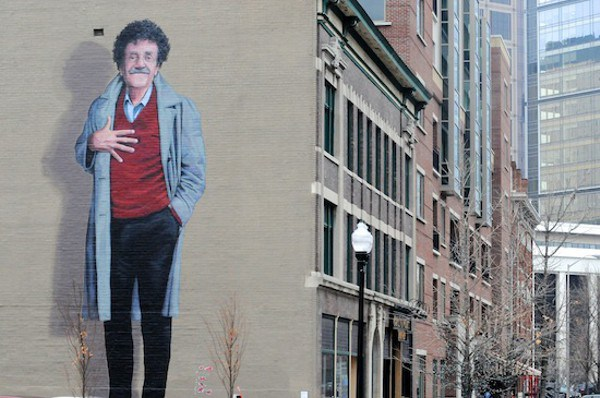 Veteran and famous Hoosier author Kurt Vonnegut, depicted in this mural on a building along Mass Ave in Indy, advocated for remembering November 11 as a way to avoid war.